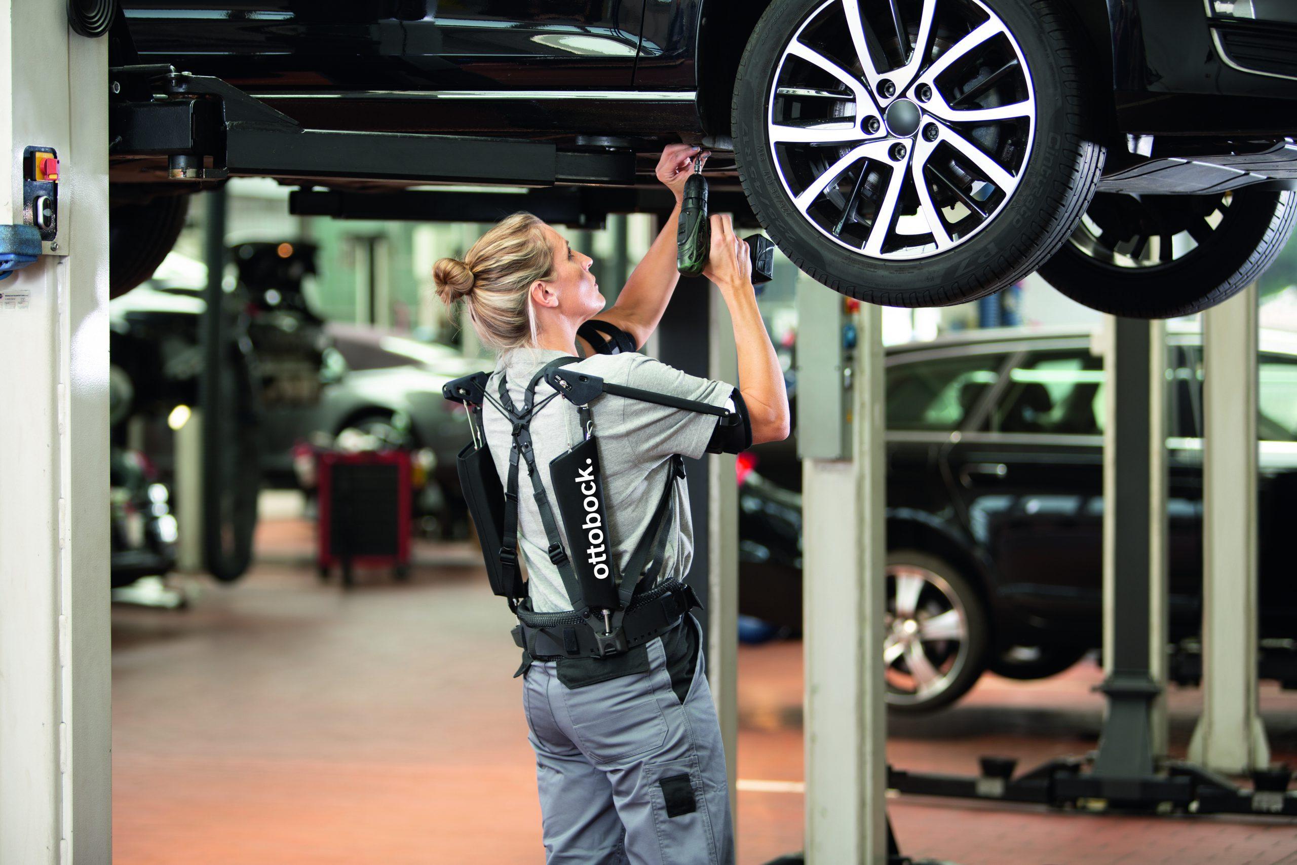 Overhead working on vehicle wearing Ottobock exoskeleton